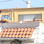 Tenant on the roof funneling his stolen water into the house.