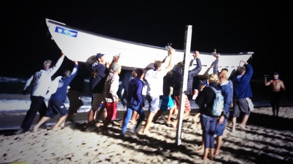 Venice Beach Lifeguards lift their dory in celebration of their Intracrew Relay Win!