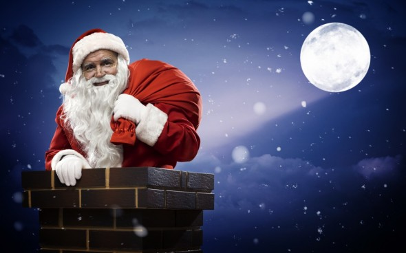 Santa Claus comes down the chimney at midnight 1280x800 590x368