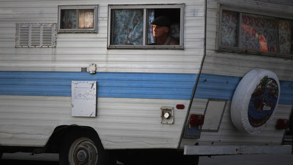 John Hefner, 48, had been living on the street for three years prior to being able to move into an RV last December, parking it in Venice. A federal appeals court on Thursday overturned L.A.'s ban on homeless people living in vehicles. (Rick Loomis / Los Angeles Times)